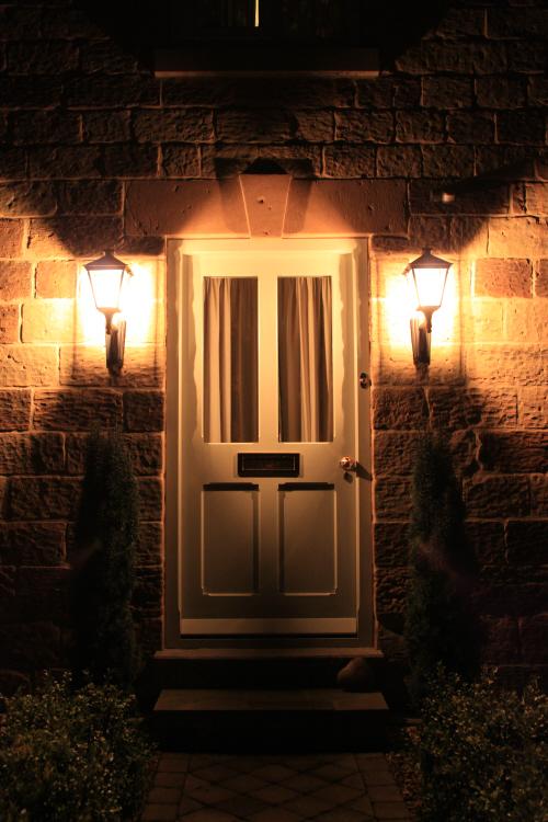 Front door simple black bracket lanterns