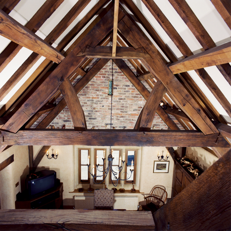 Dramatic lit traditional oak beamed roof by SEEC