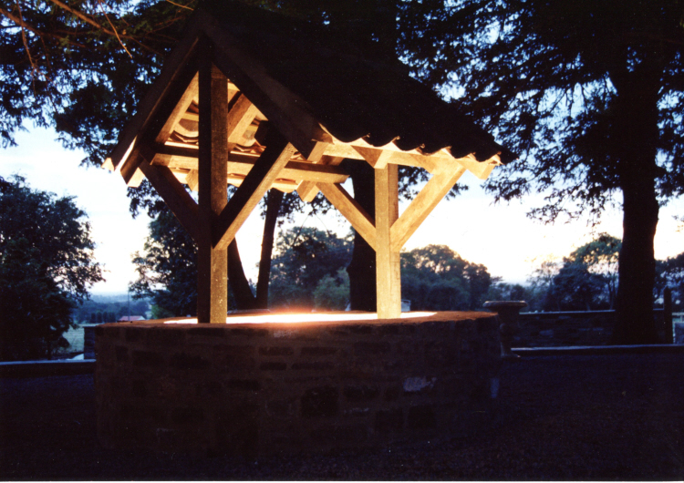 Old well roof up lit by SEEC