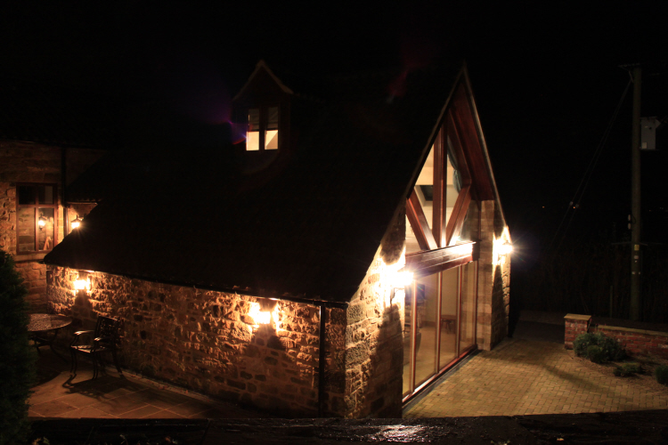 Outside traditional lantern wall lights illuminate terraces