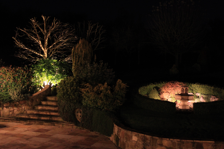 Softly lit water feature and steps with LED to save money and maintenance costs
