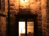Traditional lighting over door to light dark corner by SEEC