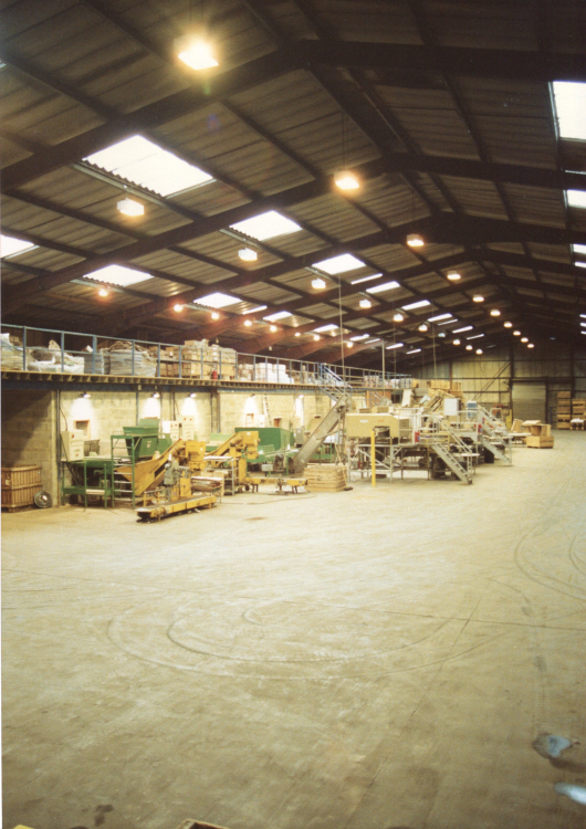 Industrial steel building with high pressure sodium low bays, maintained and installed